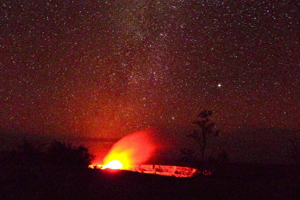 Stars, and the glow over the Halemaumau crater of the Kilauea volcano on Big Island, Hawaii