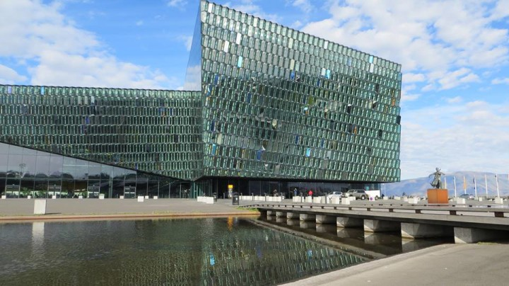 The Harpa in the sunlight is very interesting to capture in photographs. The windows have different tints and the blue skies reflect beautifully in the glass.