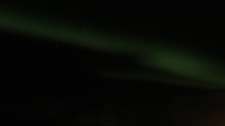 To capture the northern lights, you really do need a professional camera that allows you to set the timing for exposures and open the aperture as wide as possible. Your cell phone isn't going to cut it. I managed to capture this with my little Canon point and shoot on the manual setting