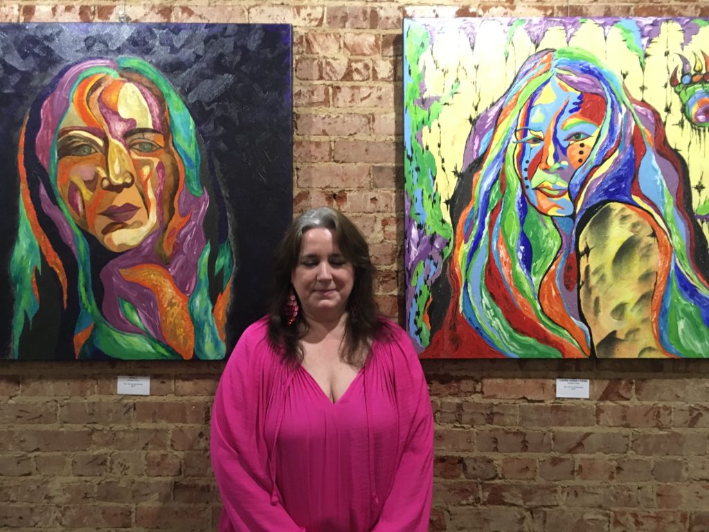 Plano artist Jennifer Turner with her paintings