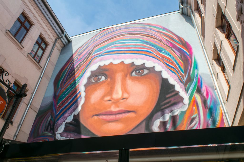 Refugee Girl Street Art in Budapest | Outside Suburbia