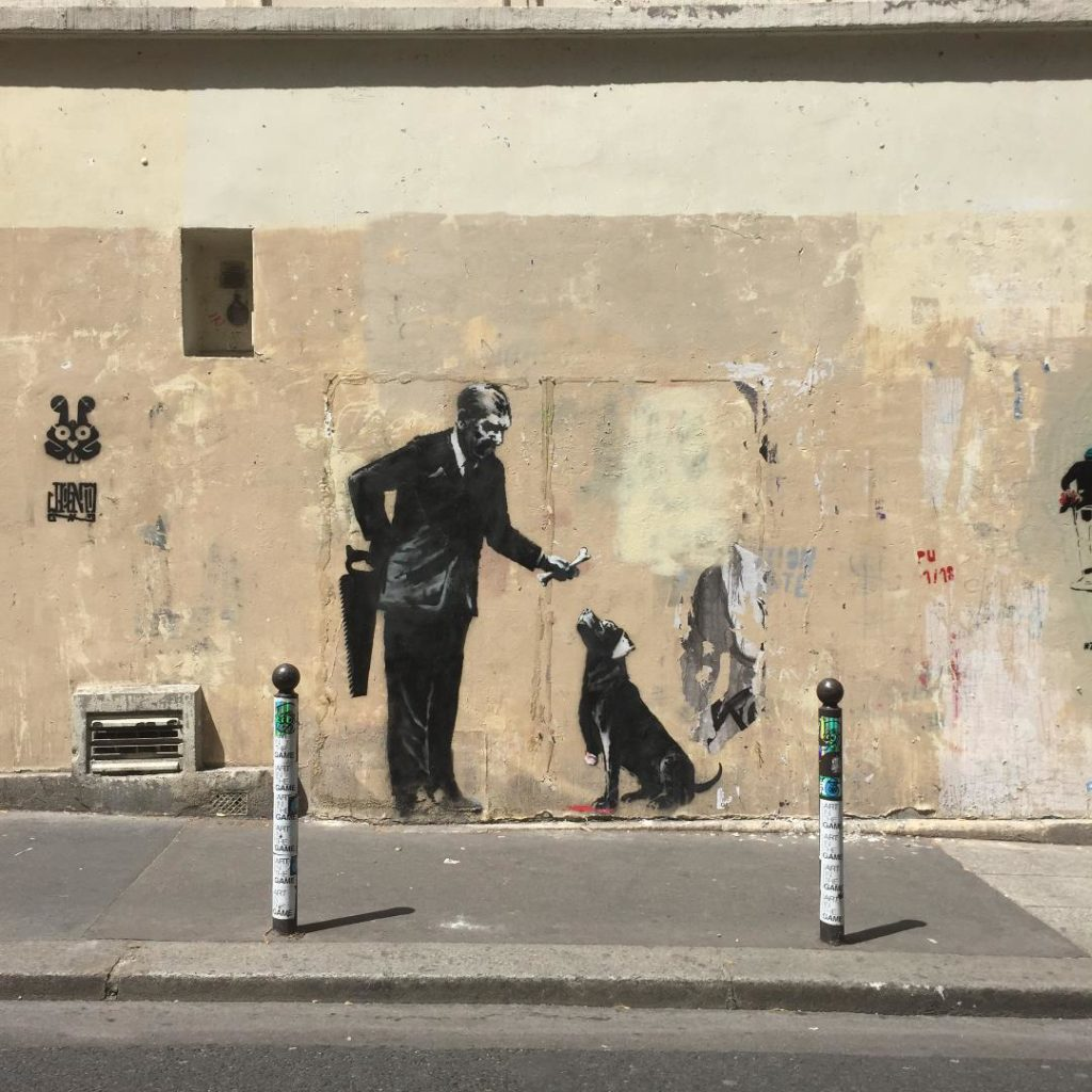 The most famous Street art mural Banksy Paris  | Outside Suburbia