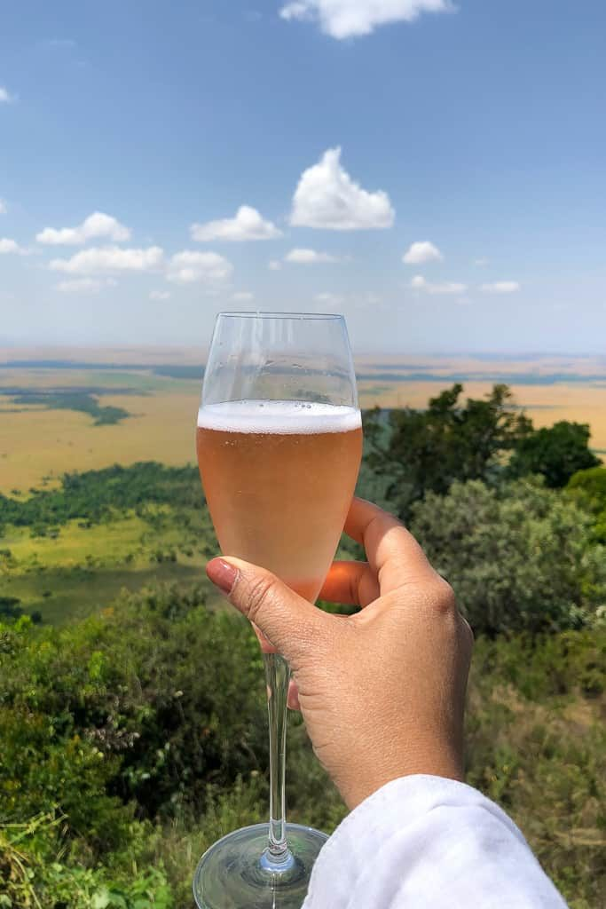 Toasting to the view - Luxury Family Safari Experience at Angama Mara, Kenya Photo by Outside Suburbia