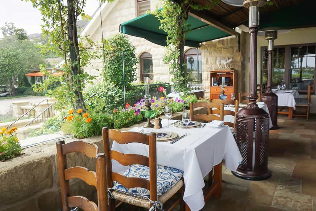 The outdoor seating area at The Stonehouse at San Ysidro Ranch