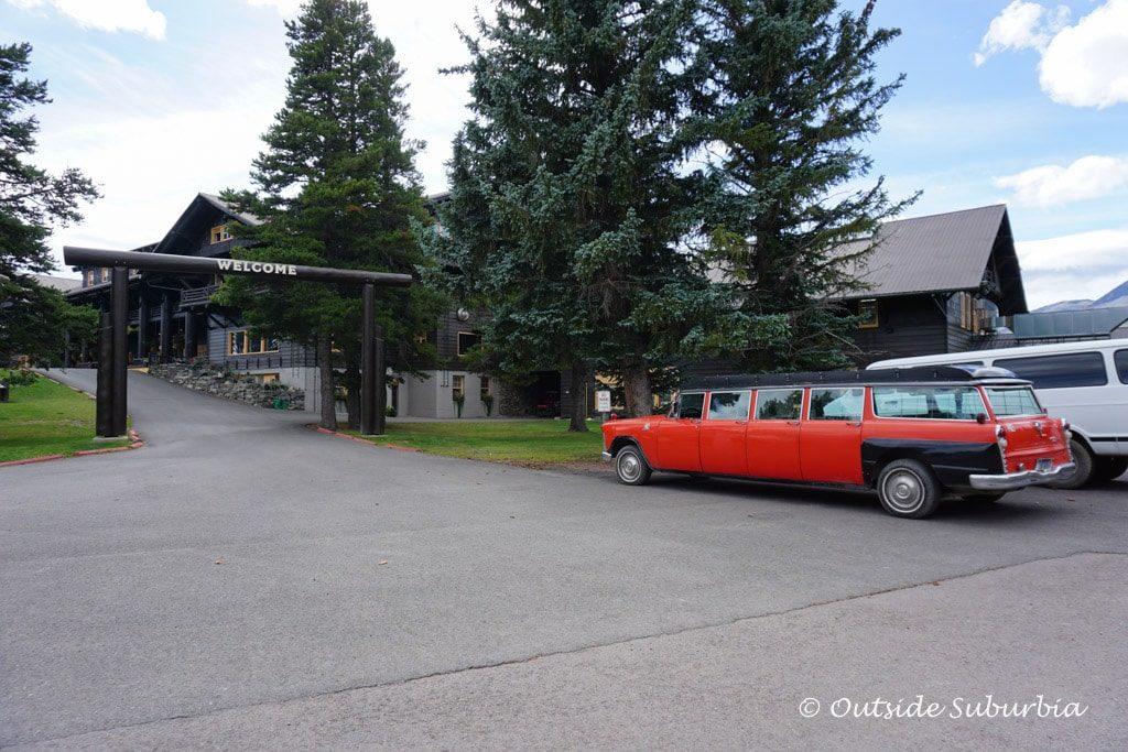 A Red Jammer in front of Glacier Park Lodge - Outside Suburbia