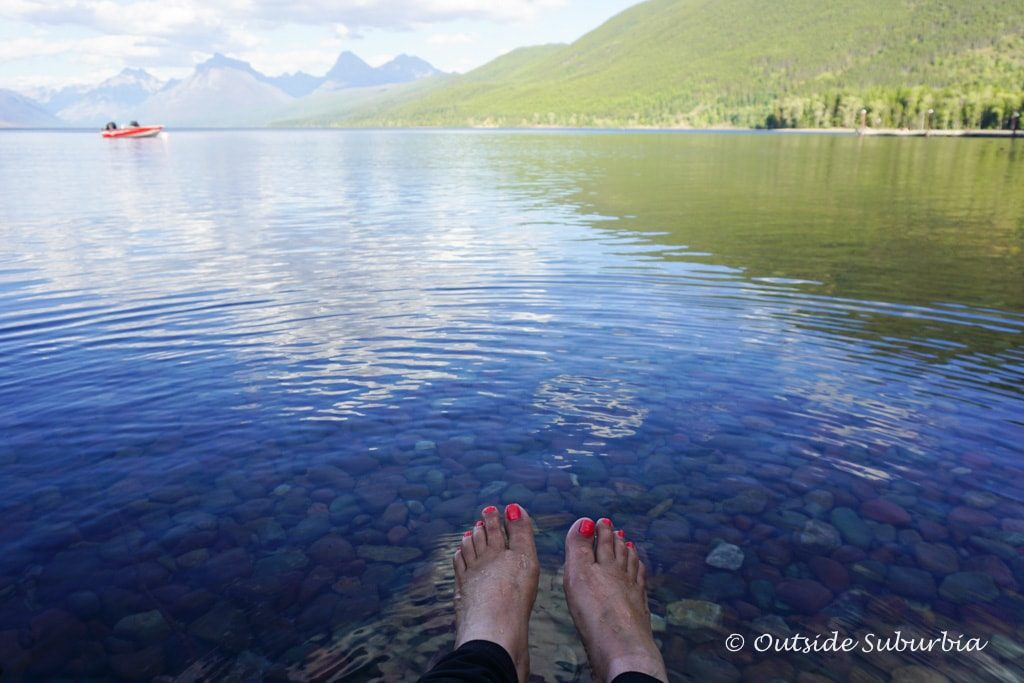 Toes in the water at Lake McDonald in Glacier National Park