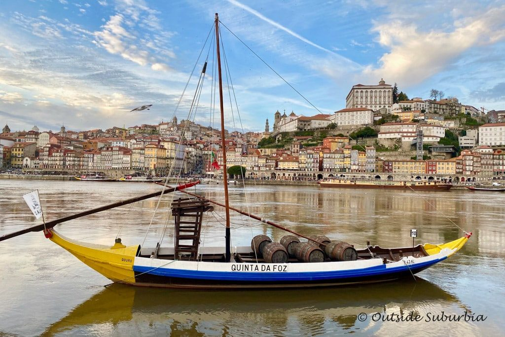 A traditional Rabelo boat sitting on the Douro river near the Wine Cellars in Porto
