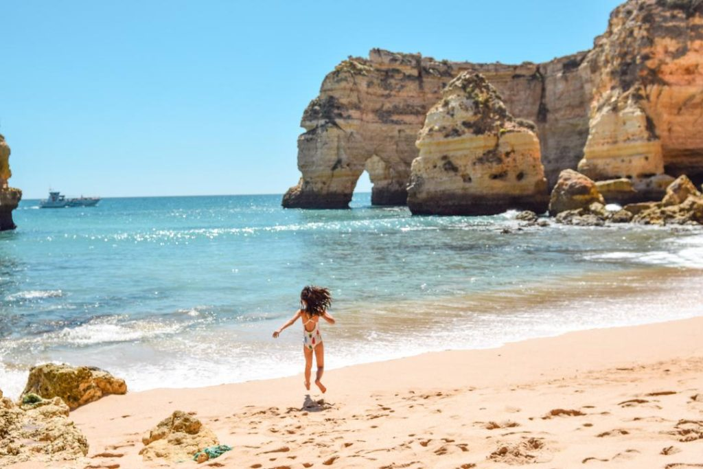 Praia da Marinha, Portugal is blessed with calmer waters perfect for kids and familes with small children - OutsideSuburbia.com