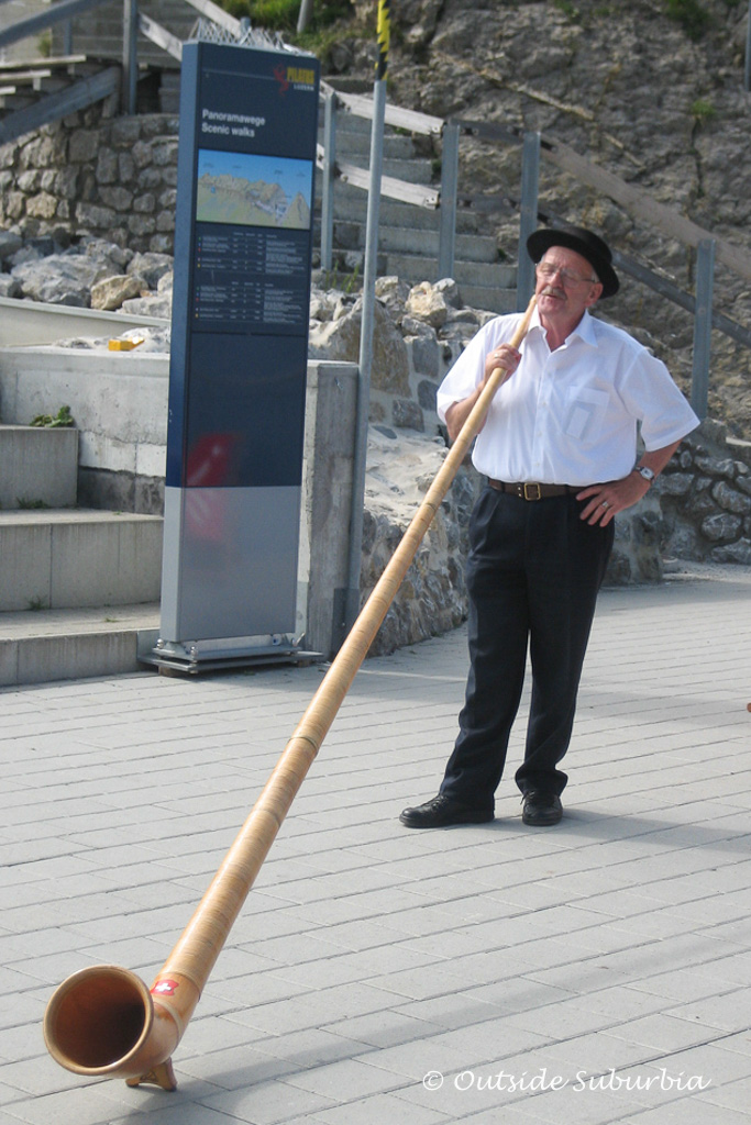 A man playing Alphorn