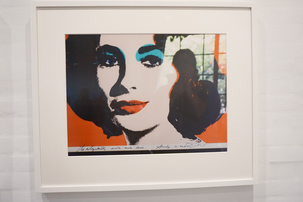Jackie on silk screen mounted on paper by Andy Warhol