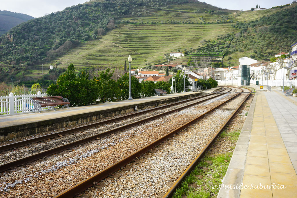 Linha do Douro train stops at the Pinhão's railway station - Outside Suburbia