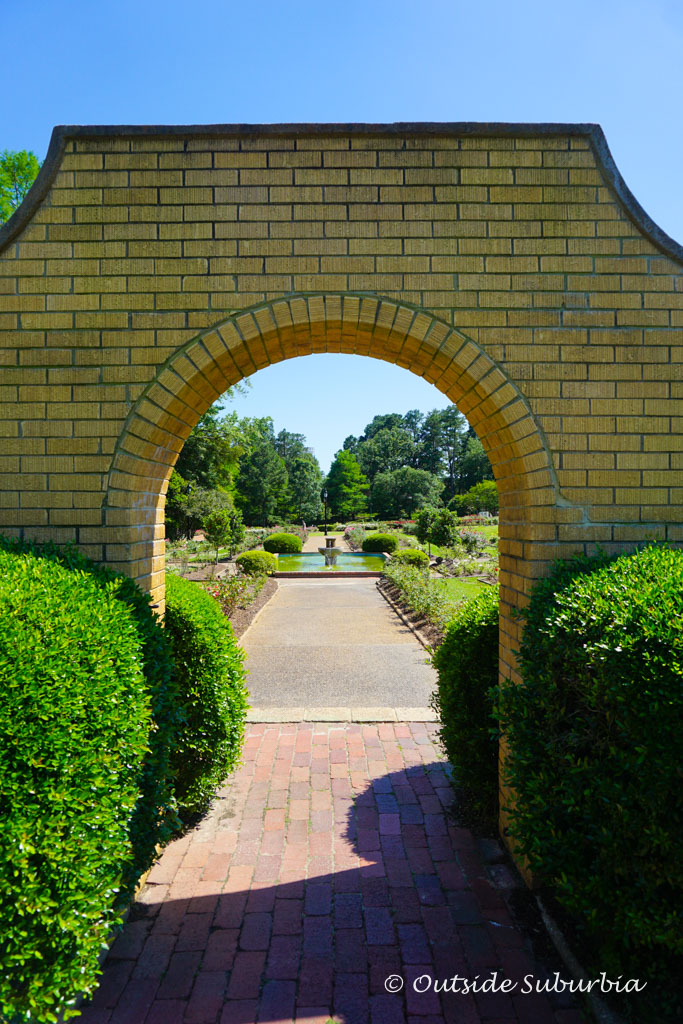 The arched yellow wall is the original entrance to the Tyler Rose Garden - Outside Suburbia