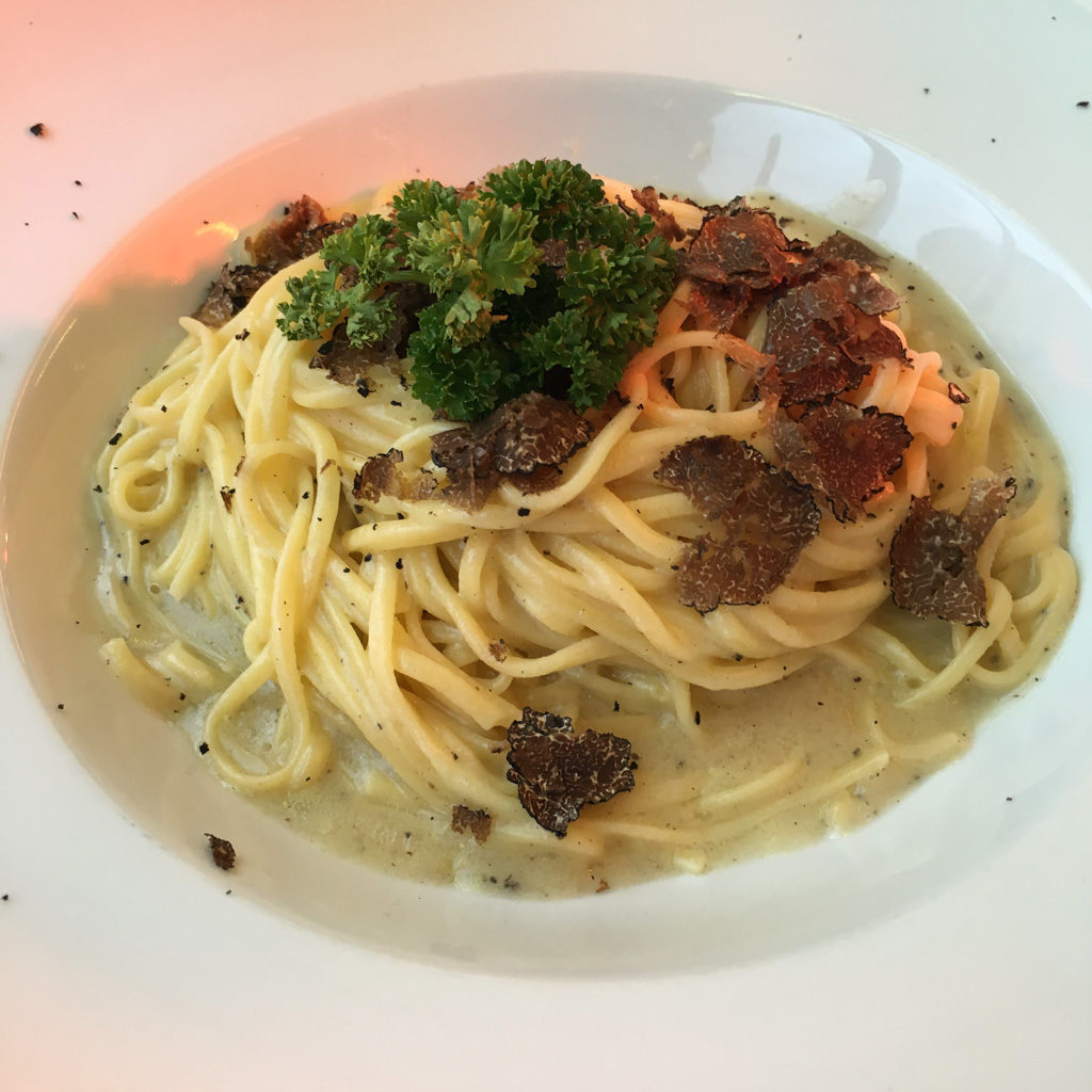 A bowl of bucatini with shaved truffles | Outside Suburbia
